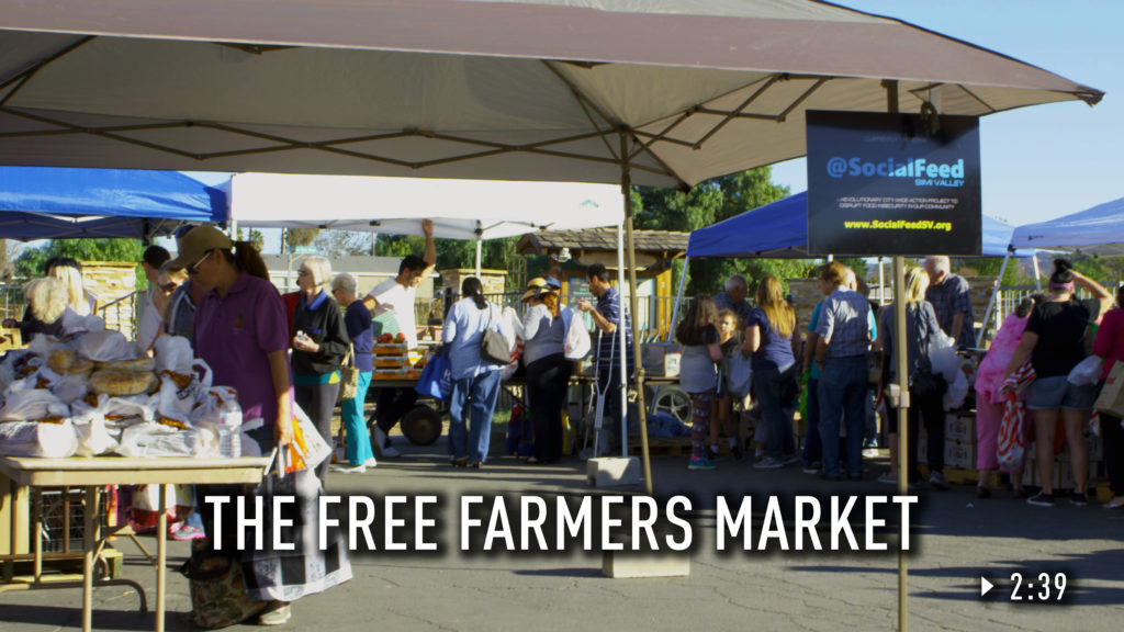 People lined up at the Free Farmer's Market.