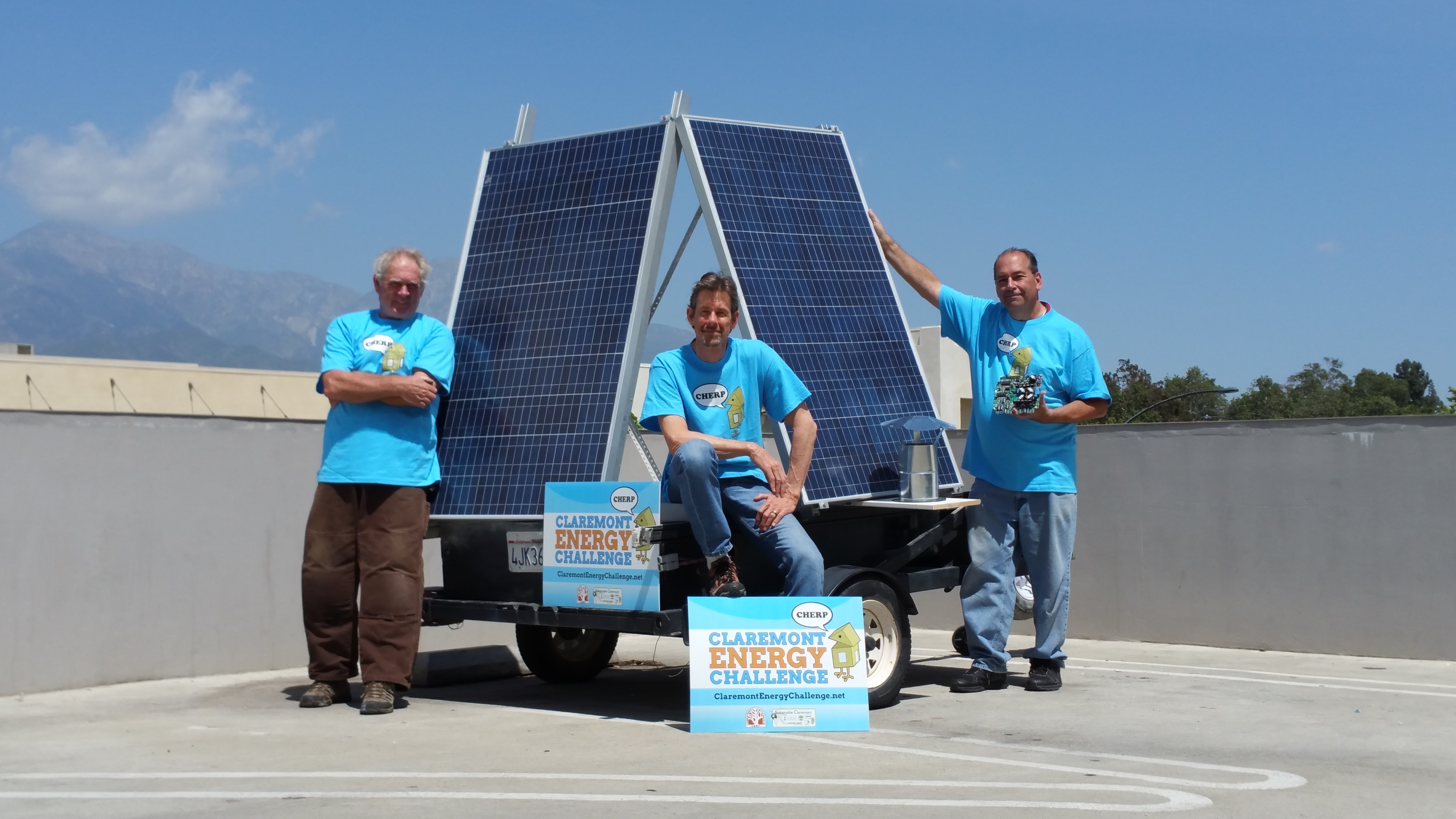CHERP members on a roof with a solar panel.