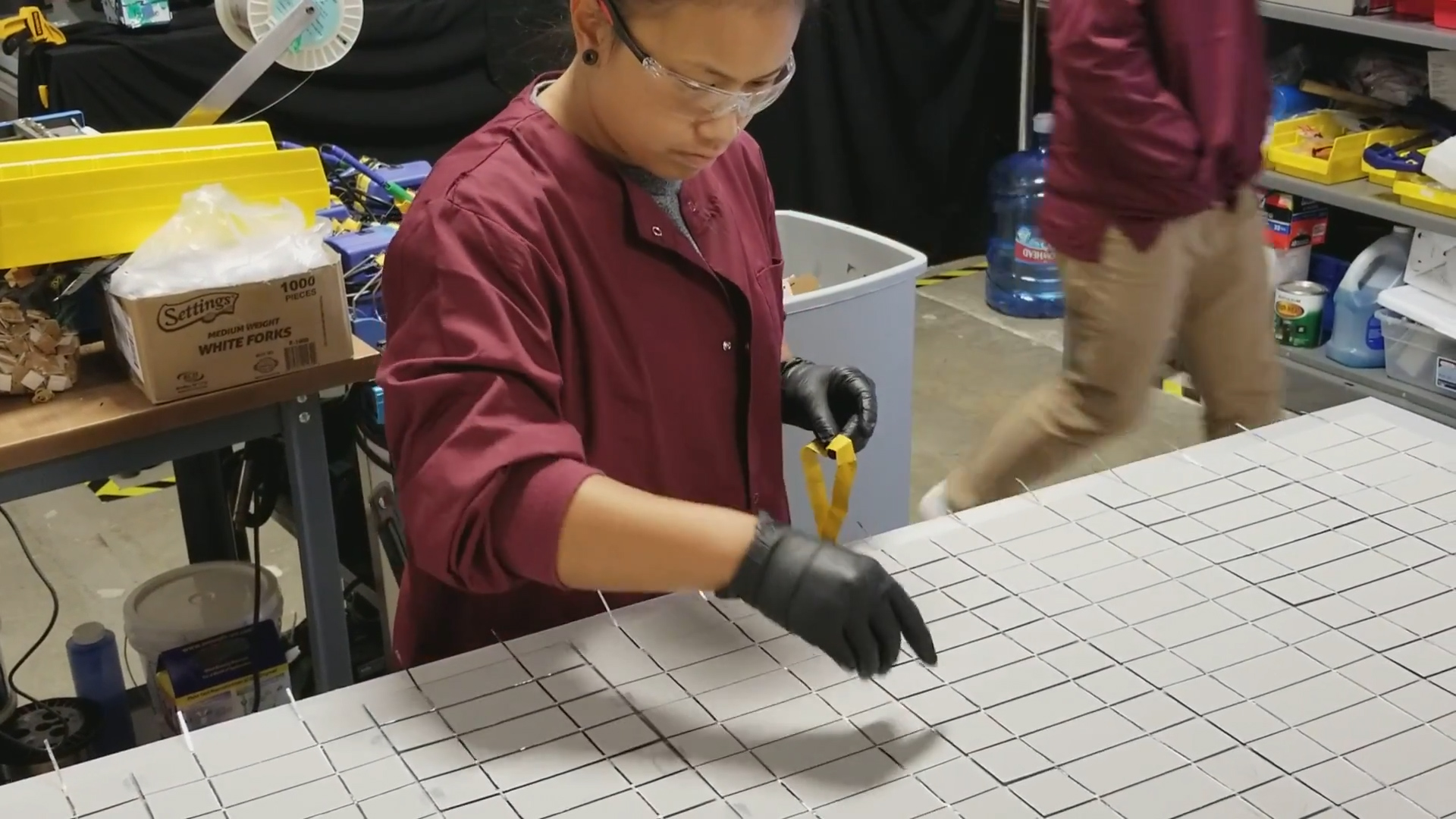 A CHERP employee assembling solar panels.
