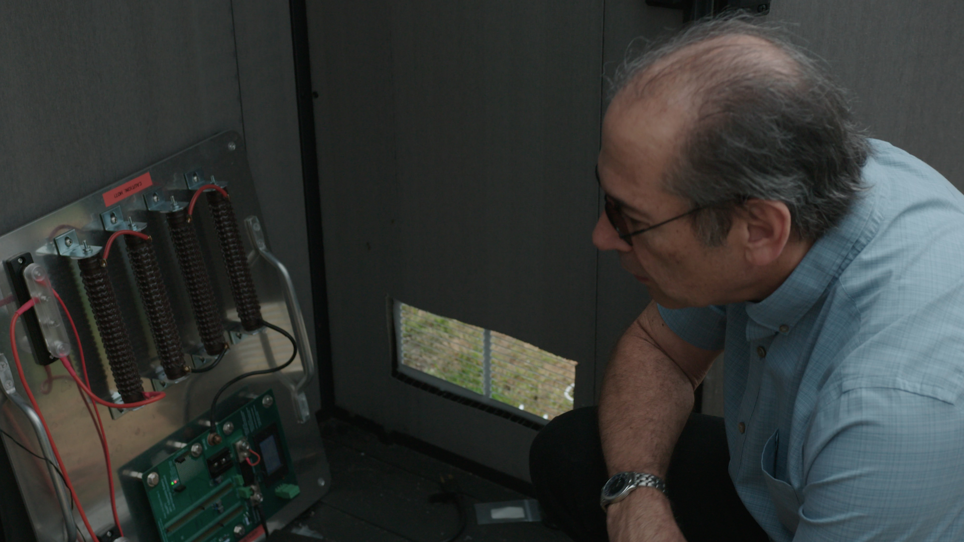 Kernahan looking at a solar panels.
