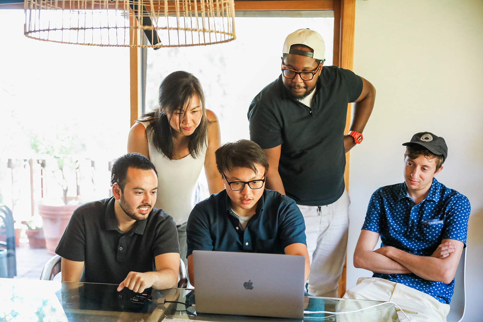 the Gladeo team editing a video